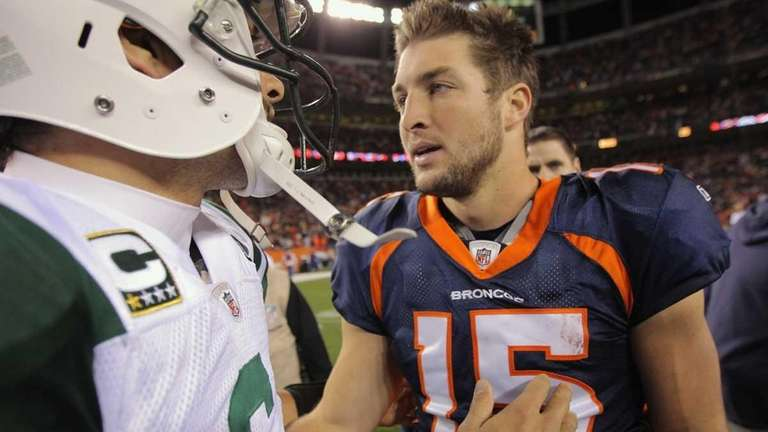 Mark Sanchez and Tim Tebow meet at midfield