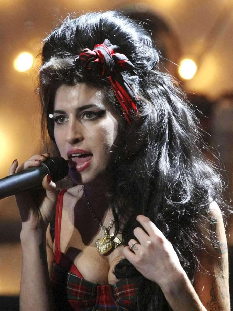 Amy Winehouse, the beehived soul-jazz diva whose self-destructive
