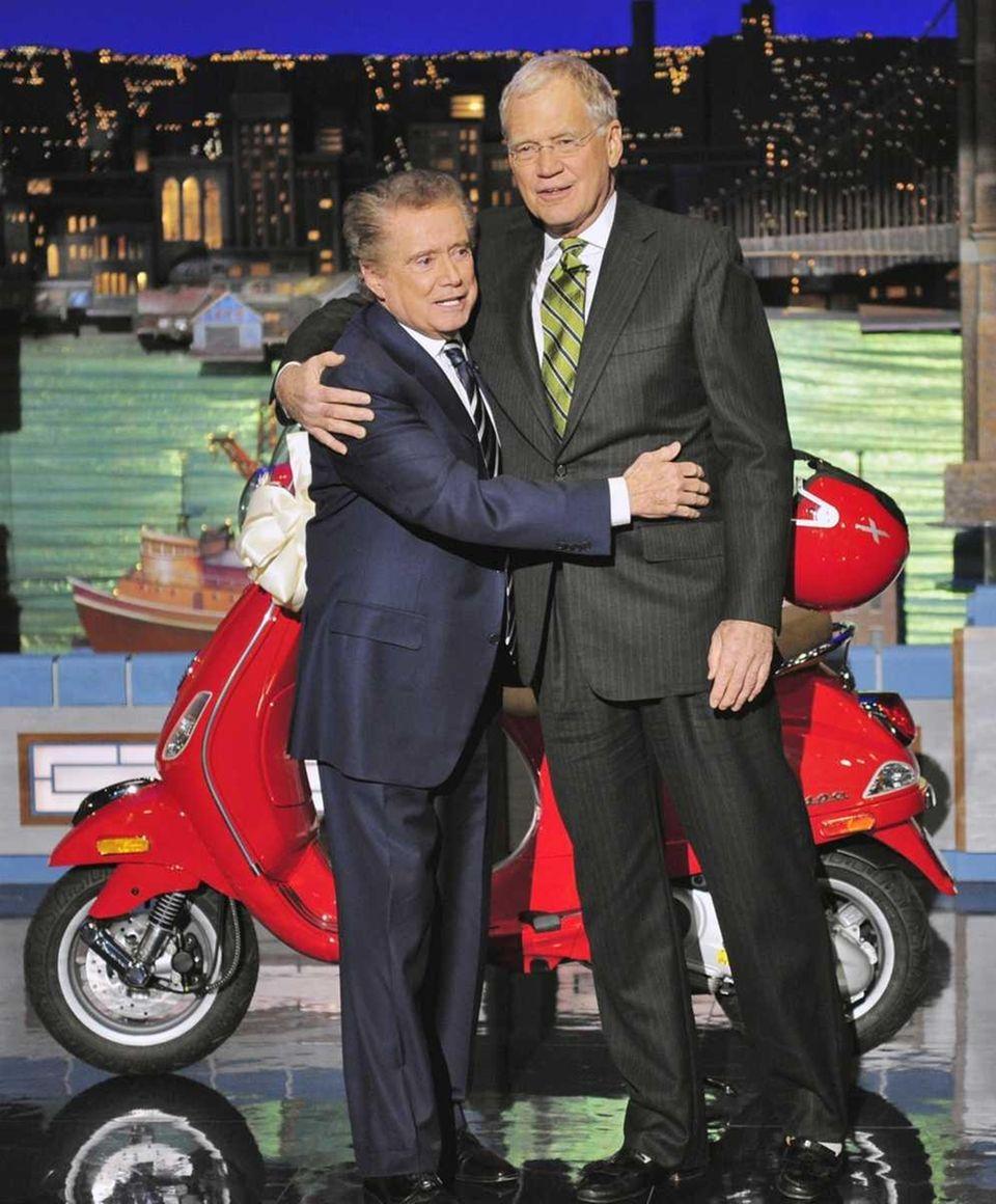 Regis Philbin embraces fellow talk show host David