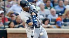 Yankees first baseman Edwin Encarnacion connects on a