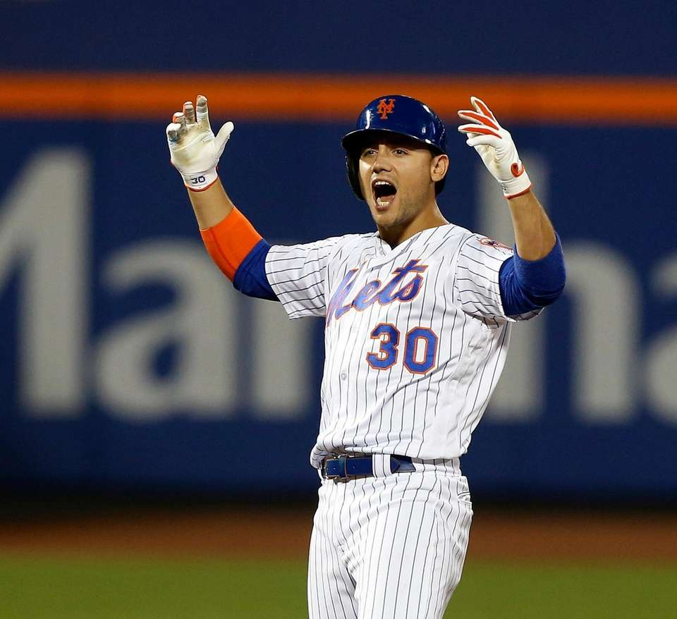 Mets outfielder Michael Conforto reacts at second base