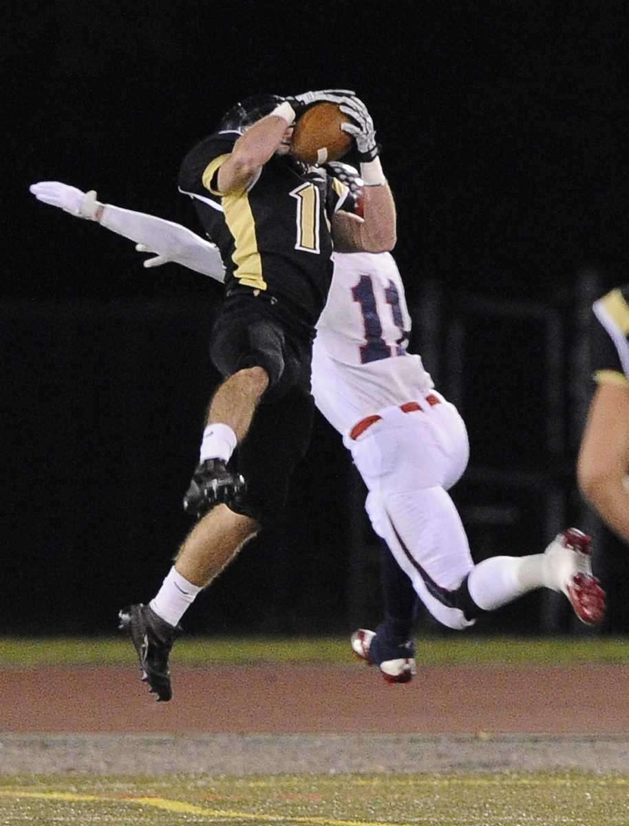 St. Anthony's Tim Stackpole intercepts a pass meant
