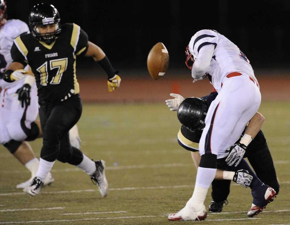 St. Anthony's Tim Stackpole makes the tackle on