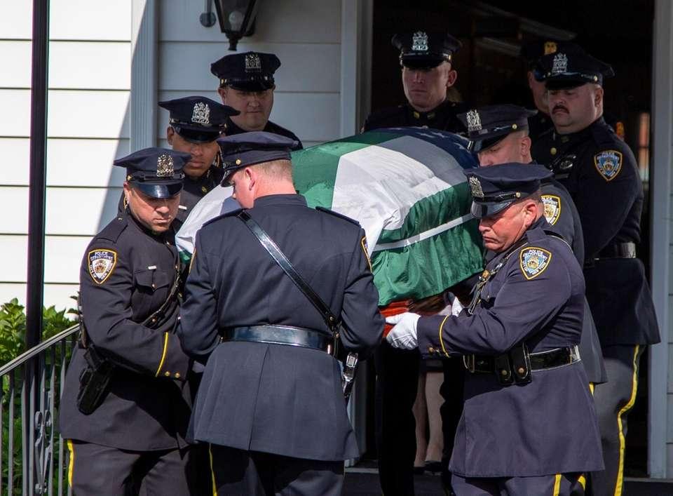 Officers carry out Luis Alvarez's coffin as they
