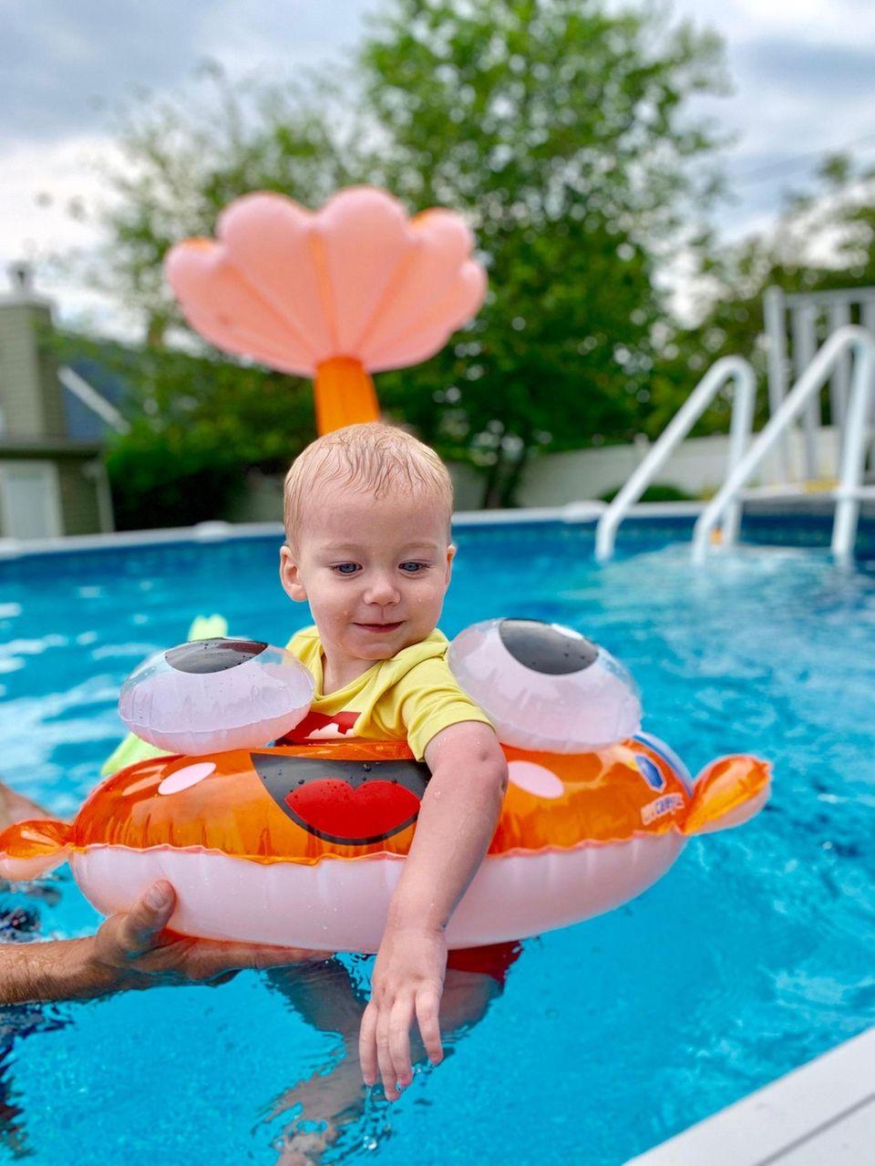Landon Wider, 1, enjoys floating in a pool