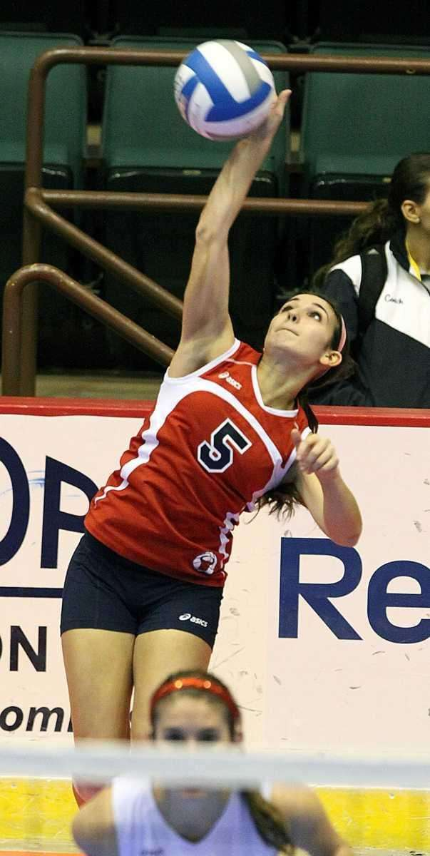 Smithtown East's Ashley Ruggiero with the serve during