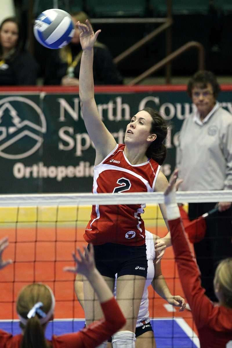 Smithtown East's Delia Phillips with the overhead during