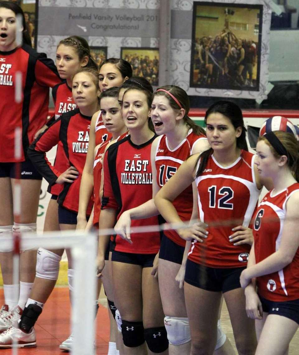 Smithtown East players cheer on their teammates during