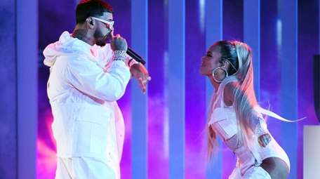 Anuel AA and Karol G perform during the