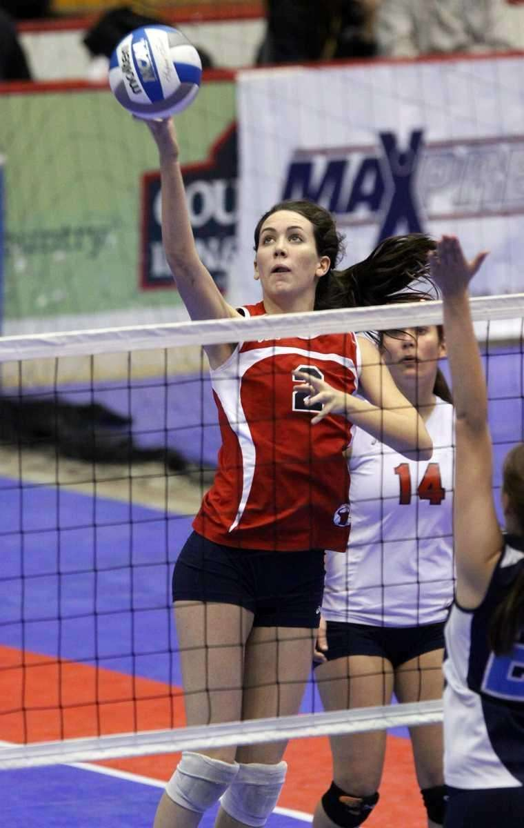 Smithtown East's Delia Phillips with the smash during
