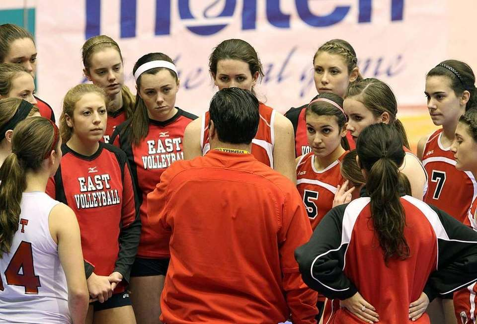 The Smithtown East team listens for instructions during