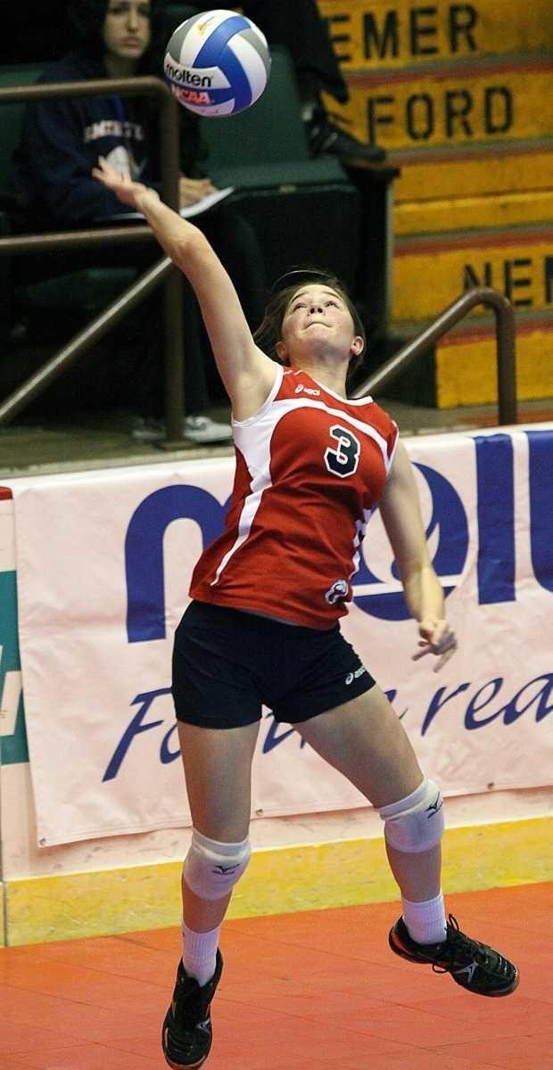 Smithtown East 's Dani Nizich with the serve
