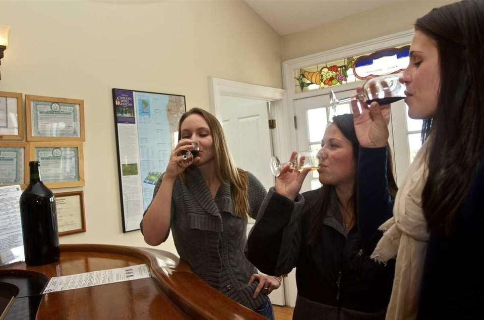 Caitlin Ruane, 26, of Northport, right, celebrates her
