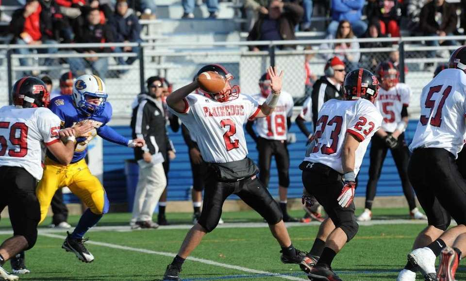 Plainedge's Nick Frenger passes during first half action