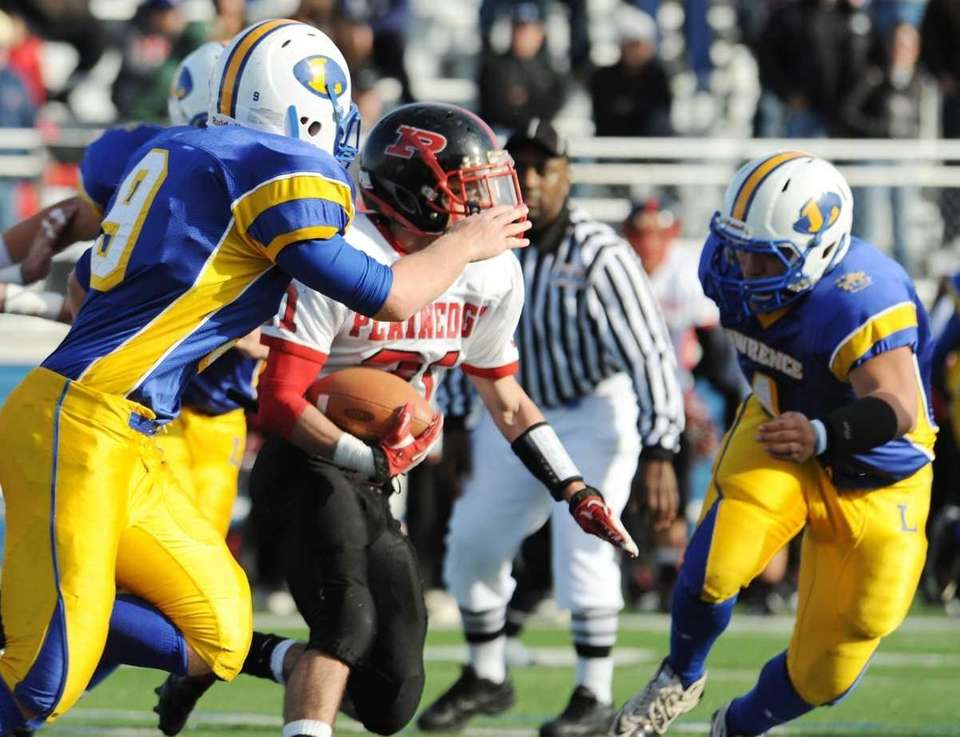 Plainedge #21 Ralph Caccavale, center, carries during first