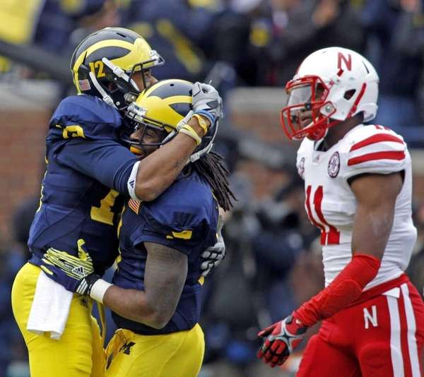 Michigan wide receiver Roy Roundtree (12) celebrates a