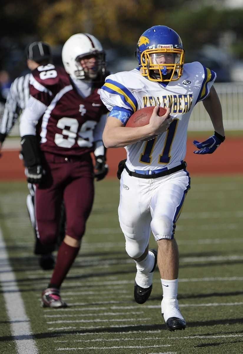 Kellenberg quarterback Matt McDaniels carries the ball for