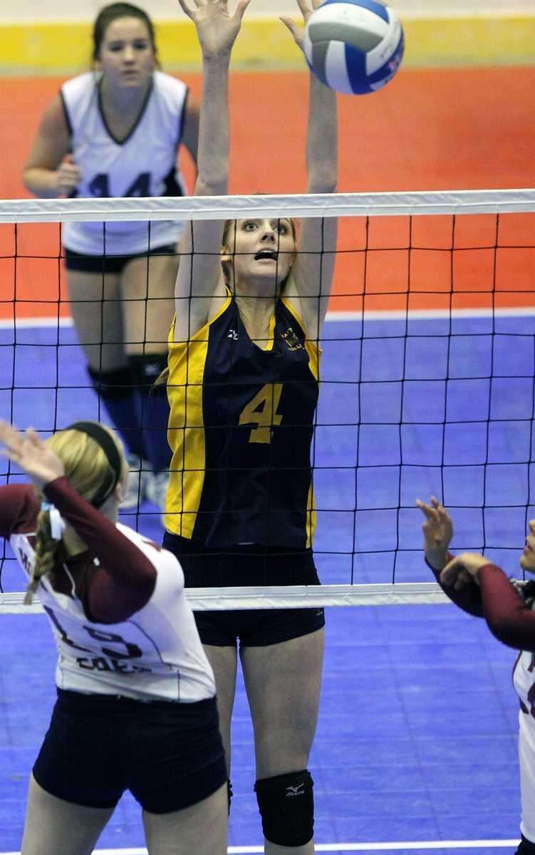 Mattituck's Clare Finnican goes for the block against