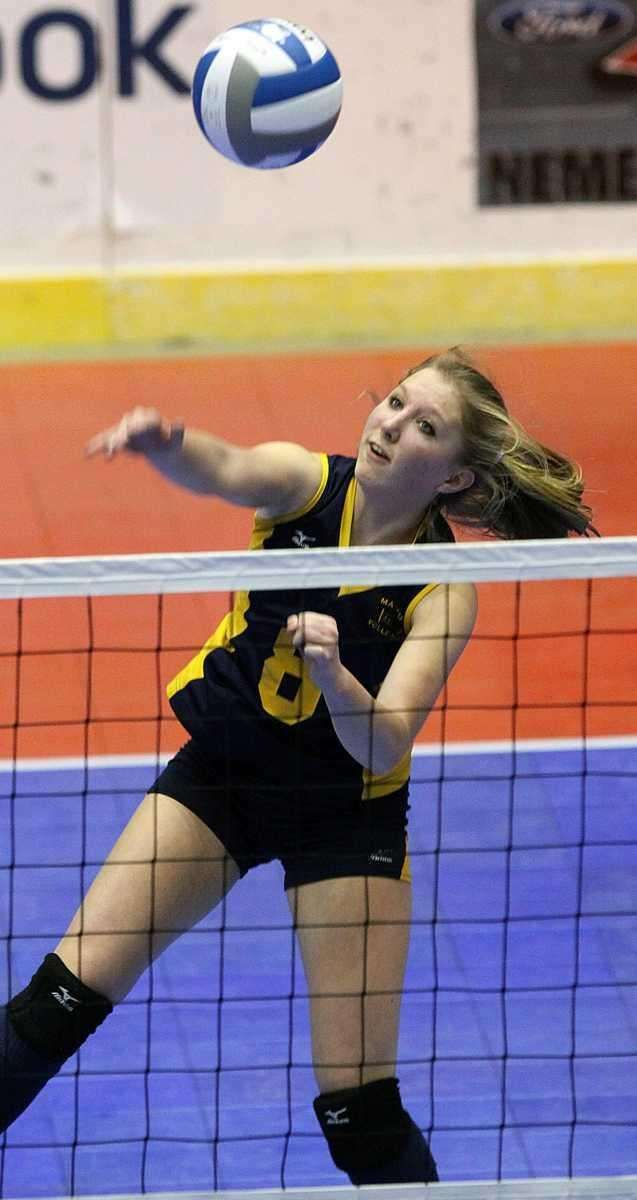 Mattituck's Kelly Cassidy with the spike. (Nov. 19,