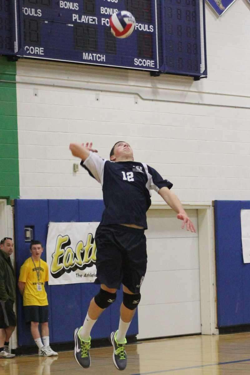 Eastport South Manor's Ryan Brisson serves the ball