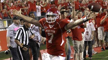 Houston quarterback Case Keenum (7) reacts after 16-yard