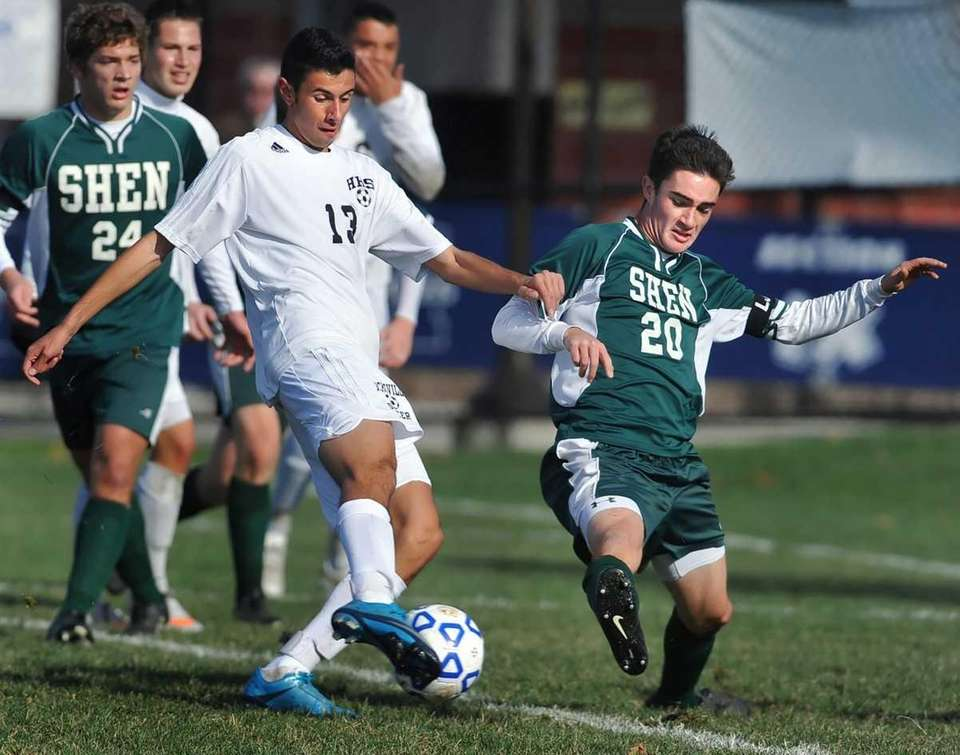 Shenendehowa's Tommy Flaim, right, stretches to block the