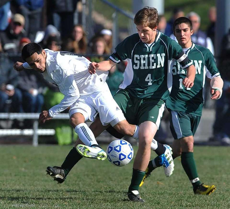 Shenendehowa's Michael Jenkins, right, gets his legs tangled