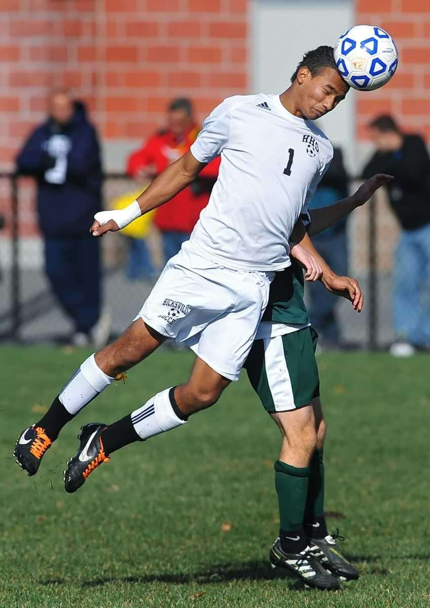 Hicksville's Marcos Bonilla jumps in front of Shenendehowa's