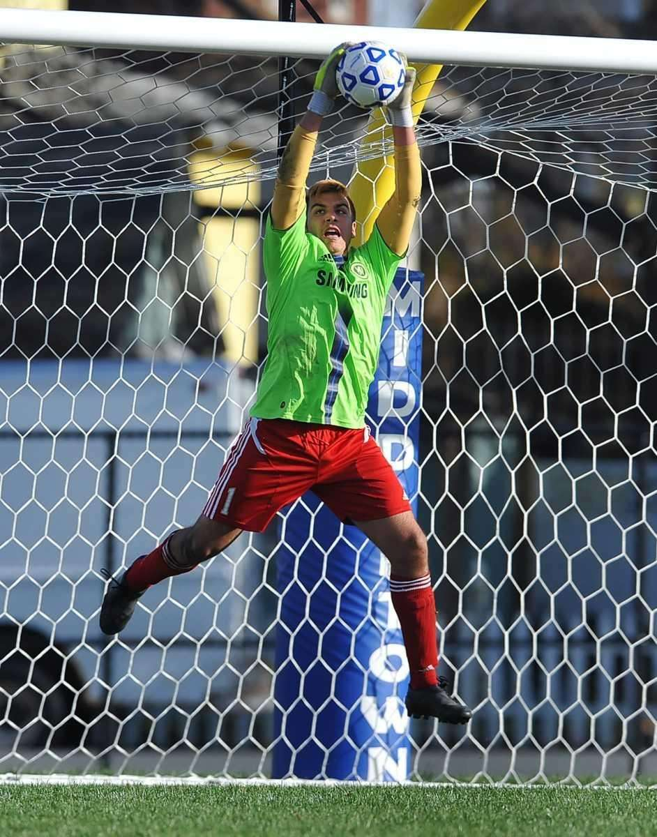 Wheatley goalkeeper Eric Orologio makes a leaping save.