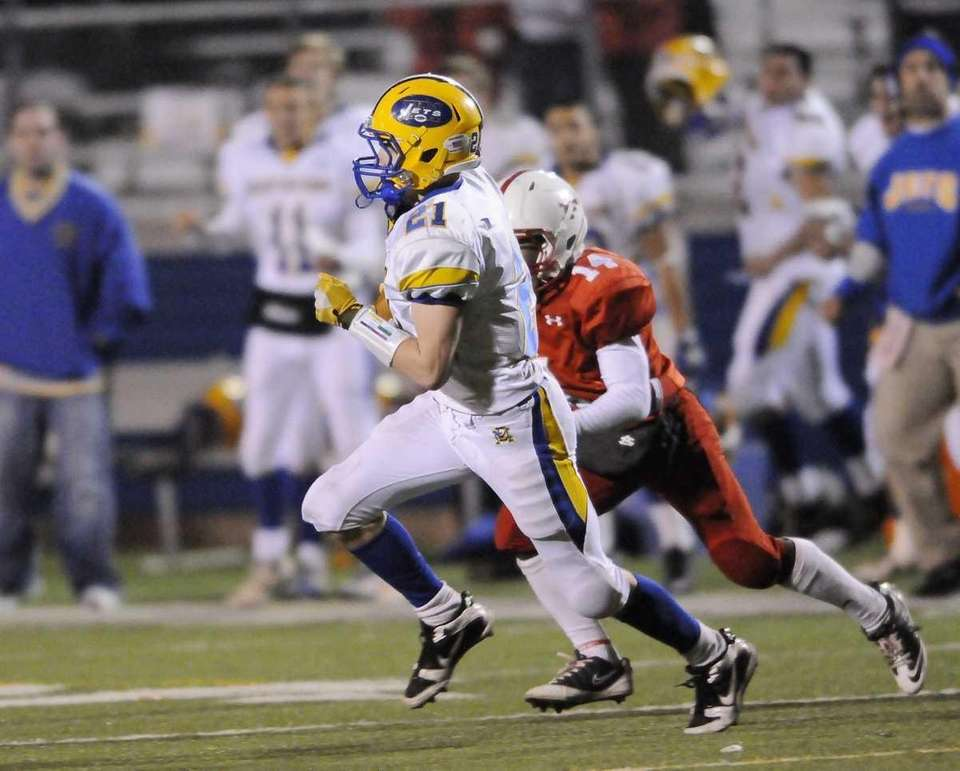 East Meadow's Robbie Healy carries during first half
