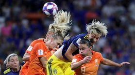 Netherlands' Sherida Spitse, front, fights for a header