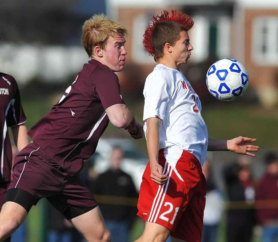 Wheatley's Jonathan Kowalczyk, right, is pressured from behind
