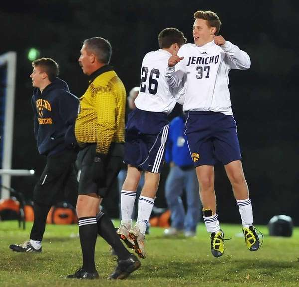Jericho's Matt Roberts, right, and Tyler Amodio celebrate