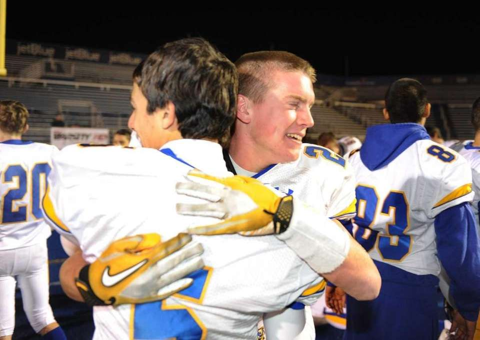 East Meadow's Robbie Healy, right, appears teary-eyed as