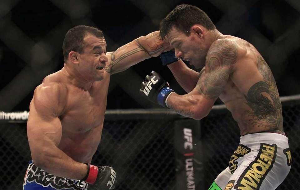 Gleison Tibau, left, punches Rafael Dos Anjos, from