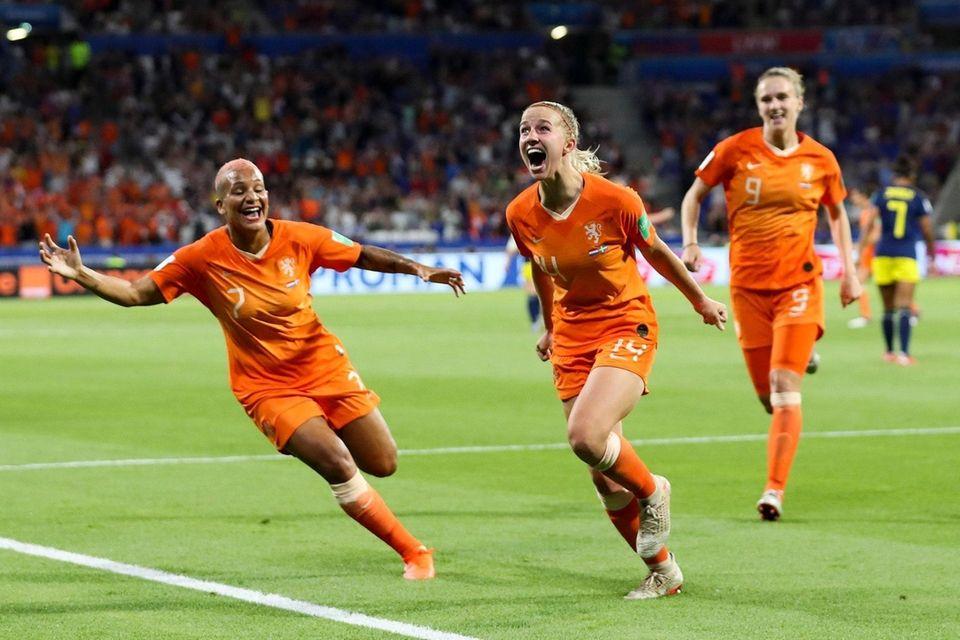 Netherlands' Jackie Groenen, center, celebrates after scoring during