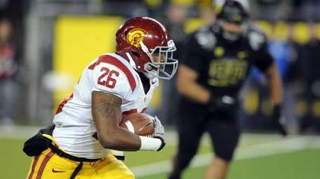 Running back Marc Tyler #26 of the USC