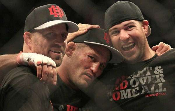 Dan Henderson, center, celebrates with teammates after beating