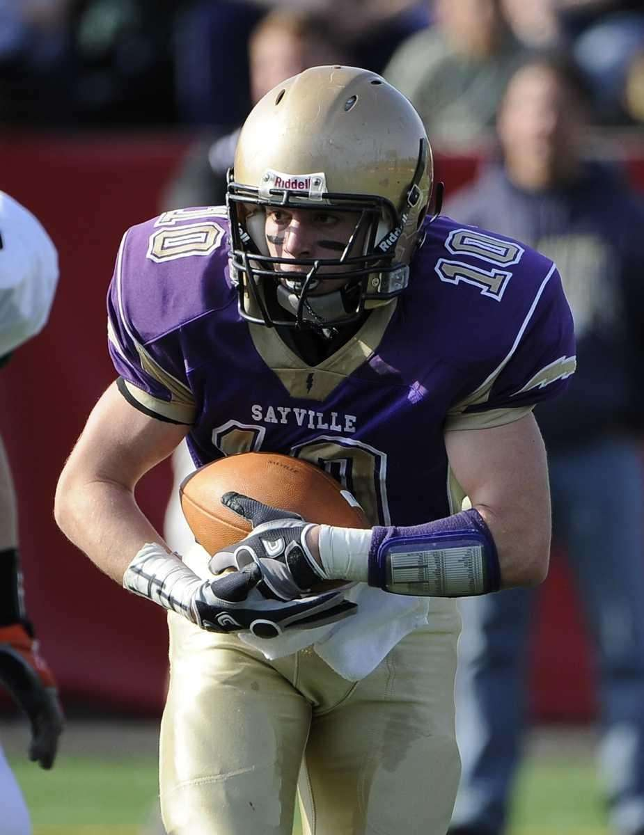 Sayville's Tom Hannan takes the hand off against