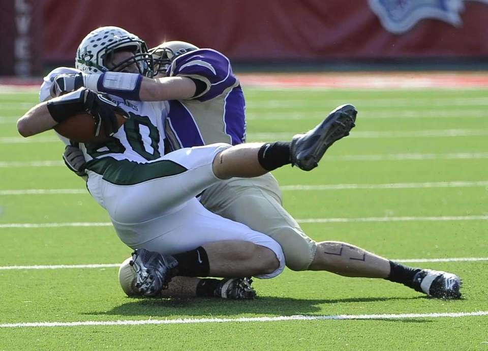 Sayville's Tom Hannon tackles Westhampton'sTJ Murphy in the
