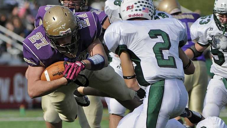 Sayville's John Haggart dives for extra yardage against