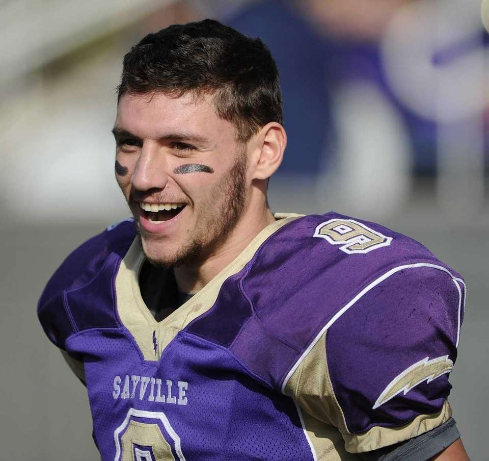 Sayville quarterback Steven Ferreira reacts during the game
