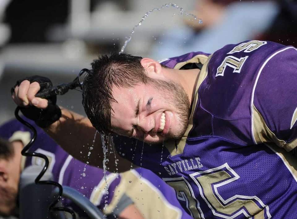 Sayville's Billy Johnson cools down during the game
