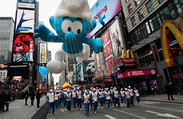 The Smurf floats through Times Square during the