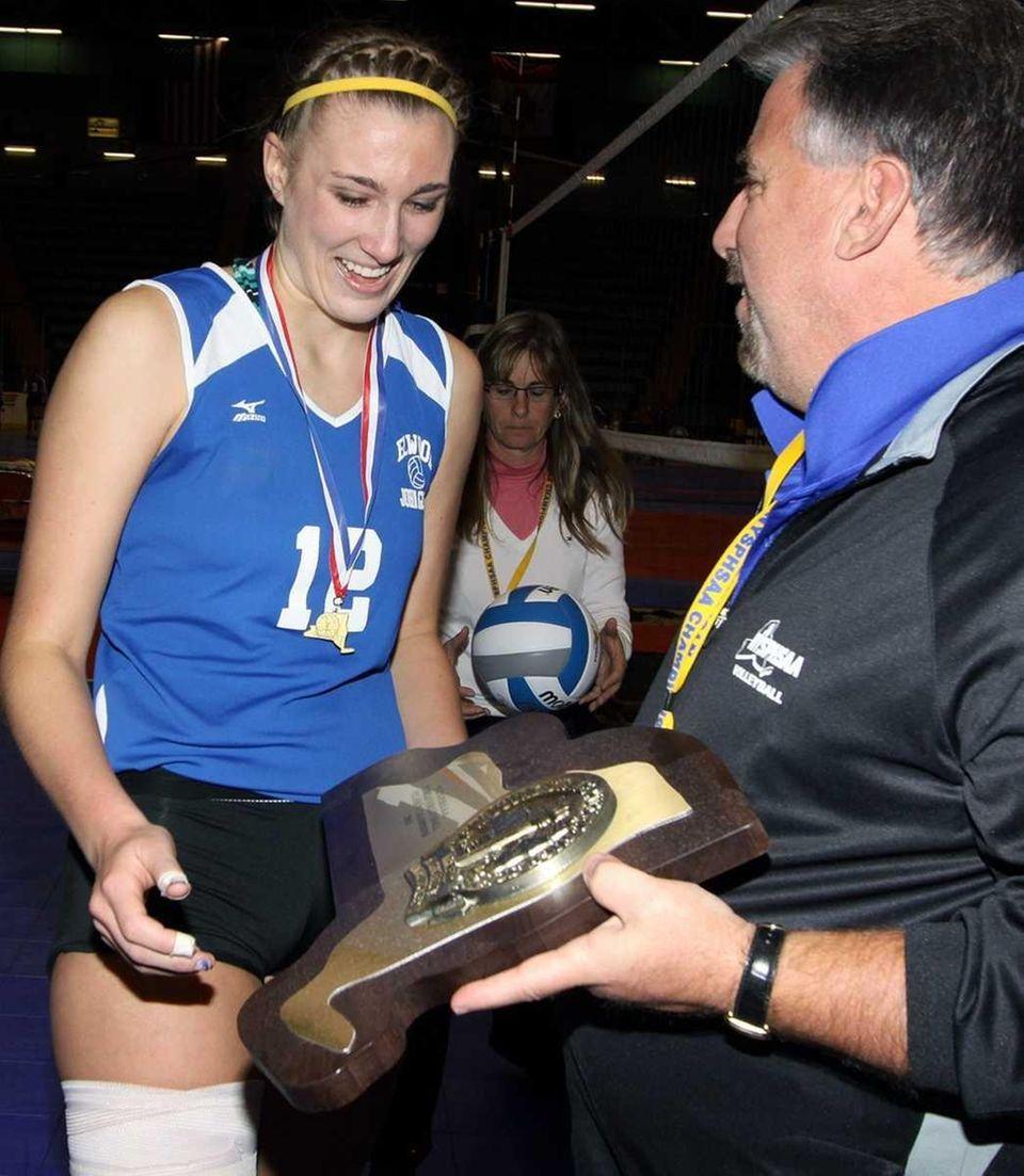 Glenn's Melissa Rigo accepts the trophy after the