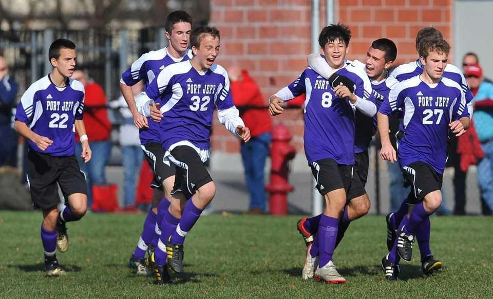 Port Jefferson players celebrate their second goal during