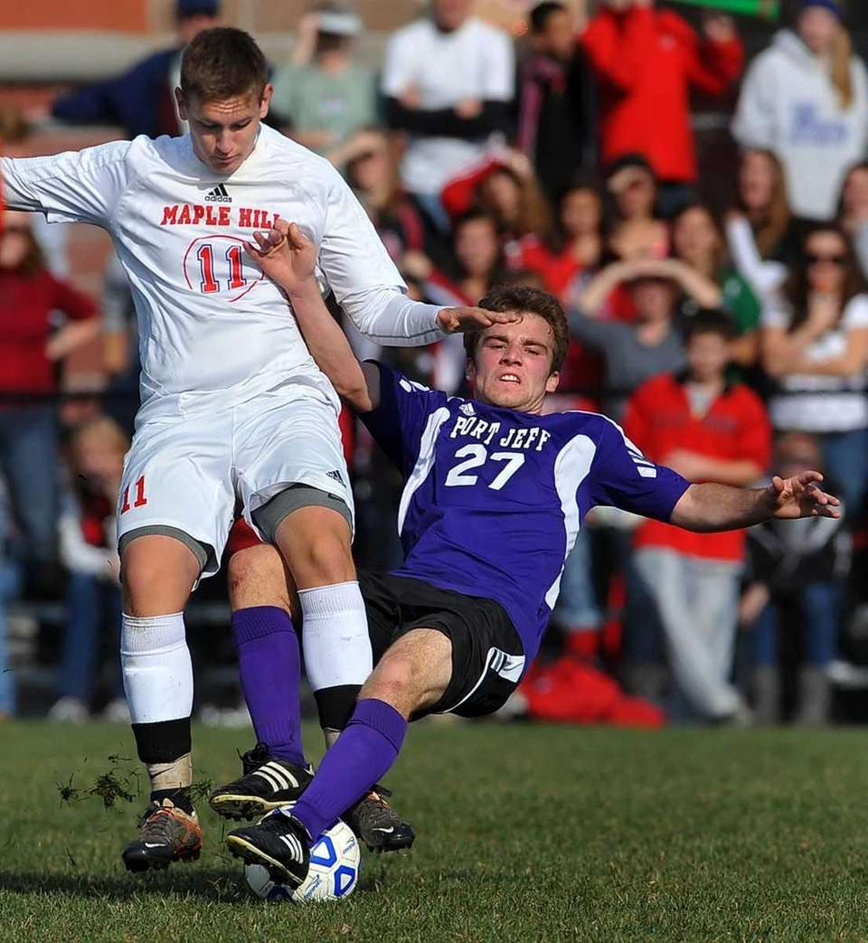 Port Jefferson's Connor Crovello, right, gets tangled with