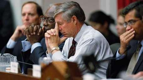 U.S. Rep. Fred Upton (R-MI)(C) pauses during the