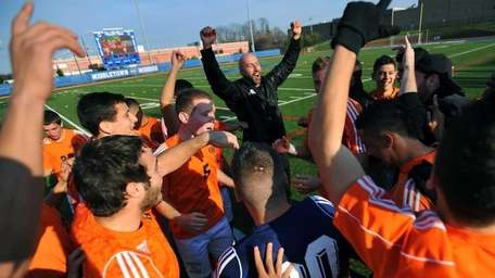 Hicksville players and coaches celebrate their win in