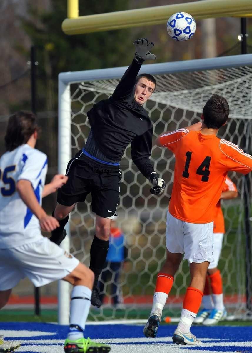 Hicksville goalkeeper Brian McPartland pushes a crossed ball